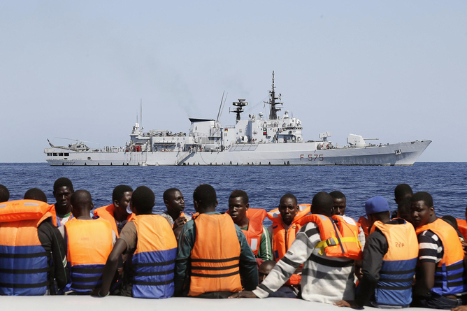 epa04966714 (FILE) A file picture dated 06 September 2014 shows Sub-Saharan migrants (front) transported to an Italian Navy vessel (background) during a rescue operation in the southern Mediterranean Sea. The European Union will launch on 07 October 2015, the first step of phase 2 of the European operation (EUNAVFOR Med) against migrant traffickers in the Mediterranean Sea. The Political and Security Committee, as a 'sign of hope', renamed the operation into 'Operation Sophia', after the name given to a baby born on a ship during an operation rescuing her mother on 22 August 2015, off the Libyan coast. The operation aims to block human smuggling and its trafficking networks, preventing further loss of life at sea. The deadliest migrants' journeys are those from Libya to Italy, with unaccounted lives lost during hazardous crossings at sea. Large masses of migrants from war-torn countries and conflict zones reached Europe in recent months, leading EU member states to deal with a migration influx crisis. EPA/GIUSEPPE LAMI